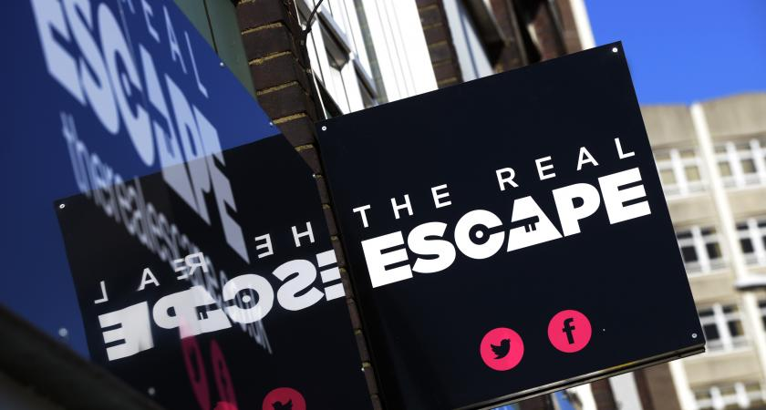 The Real Escape sign